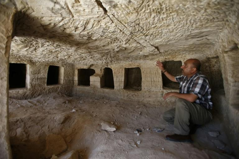 Taleb Jubran, director of the department of tourism and antiquities in Hebron, points to a Roman-era burial site discovered near the West Bank city of Hebron, on August 16, 2018