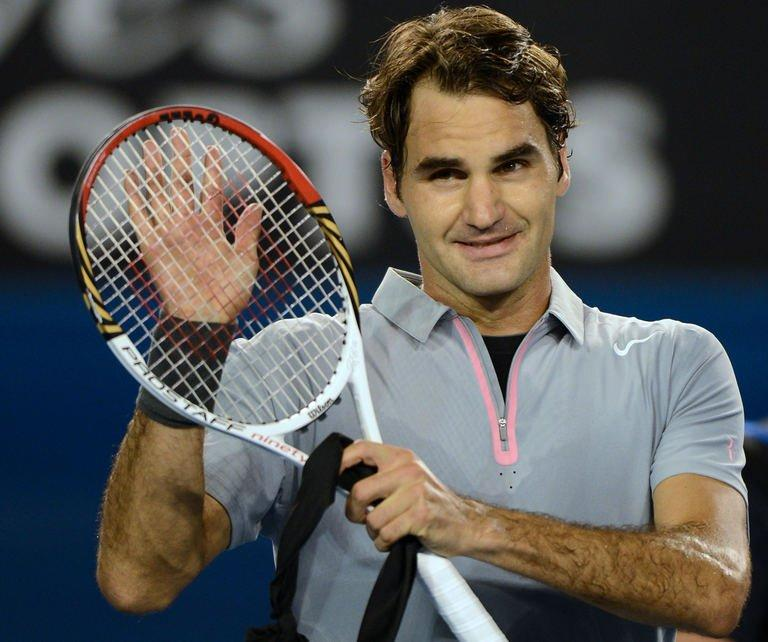 Roger Federer celebrates his victory over Jo-Wilfried Tsonga in Melbourne, on January 23, 2013