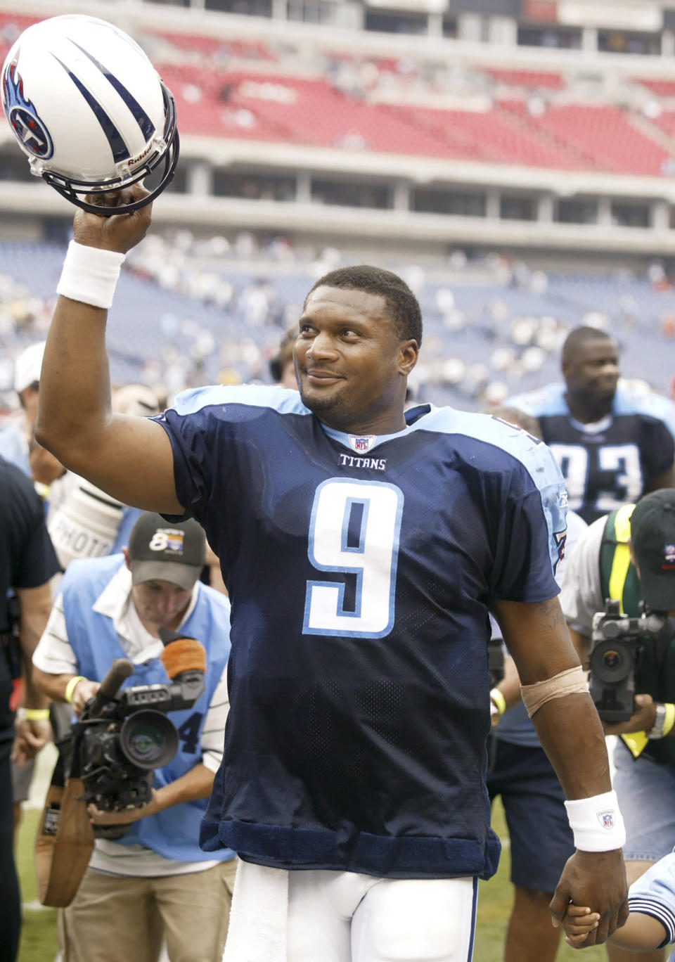 FILE - In this Sept. 21, 2003, file photo, Tennessee Titans quarterback Steve McNair leaves the field after the team's 27-12 win over the New Orleans Saints in Nashville, Tenn. The Tennessee Titans retiring Eddie George's No. 27 and the No. 9 of the late Steve McNair has turned from a simple halftime ceremony into a celebration and team reunion. (AP Photo/Wade Payne)