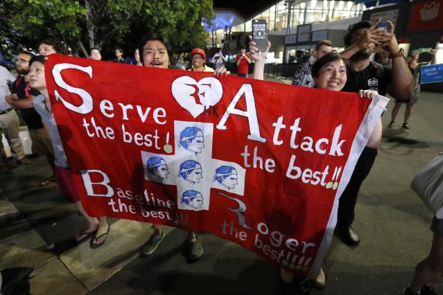 Tennis - Australian Open - Men's singles final - Rod Laver Arena, Melbourne, Australia, January 28, 2018. Fans of Switzerland's Roger Federer display a banner as they celebrate outside the Rod Laver Arena after he won the final against Croatia's Marin Cilic.