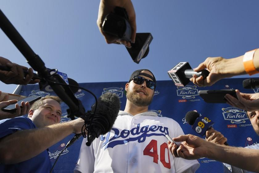 Los Angeles Dodgers' pitcher Jimmy Nelson is interviewed by reporters during Dodger Stadium FanFest.