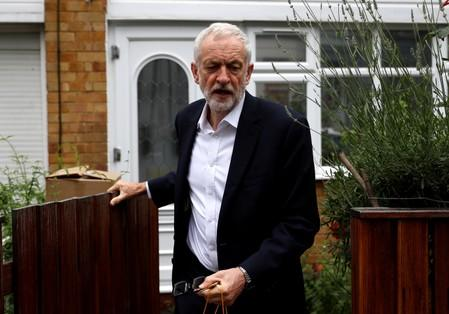 Britain's Labour Party leader Jeremy Corbyn leaves his home in London