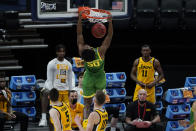 Oregon forward Eric Williams Jr. (50) dunks against Iowa during the first half of a men's college basketball game in the second round of the NCAA tournament at Bankers Life Fieldhouse in Indianapolis, Monday, March 22, 2021. (AP Photo/Paul Sancya)