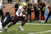 Boston College running back Pat Garwo III (24) carries the ball as Cincinnati safety Ja'von Hicks (3) tries to tackle him during the first half of the Birmingham Bowl NCAA college football game Thursday, Jan. 2, 2020, in Birmingham, Ala. (AP Photo/Butch Dill)