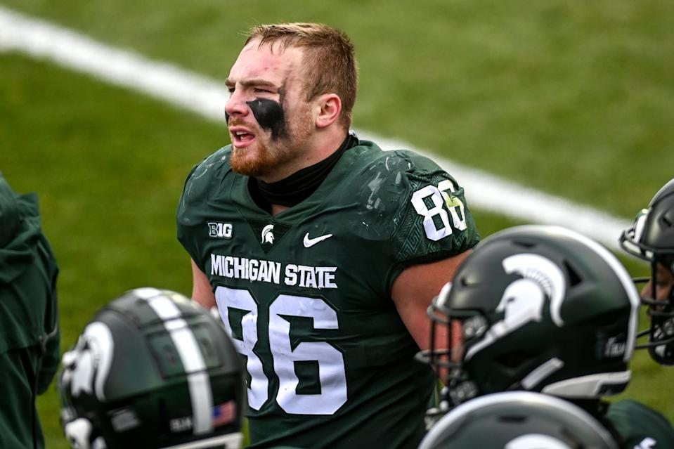 Michigan State's Drew Beesley looks on after getting penalized for roughing Ohio State's quarterback Justin Fields during the second quarter on Saturday, Dec. 5, 2020, at Spartan Stadium in East Lansing.