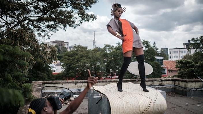 After a fashion designer and photographer's scheduled work is cancelled due to coronavirus, the house mates do their own shoot on Monday on the top of their apartment block in Kenya's capital Nairobi.