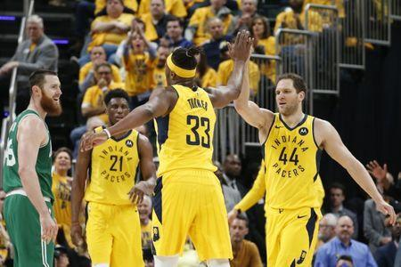 Apr 19, 2019; Indianapolis, IN, USA; Indiana Pacers center Myles Turner (33) receives a high five from forward Bojan Bogdanovic (44) during the third quarter in game three of the first round of the 2019 NBA Playoffs against the Boston Celtics at Bankers Life Fieldhouse. Mandatory Credit: Brian Spurlock-USA TODAY Sports