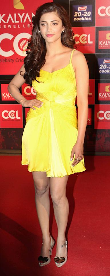 Actress Shruti Hassan sports a bright canary yellow dress.