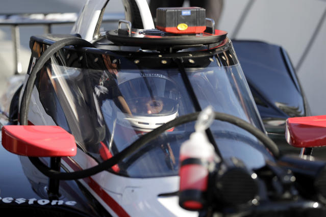 Will Power, of Australia, sits in his car during the Aeroscreen testing at Indianapolis Motor Speedway, Wednesday, Oct. 2, 2019, in Indianapolis. (AP Photo/Darron Cummings)
