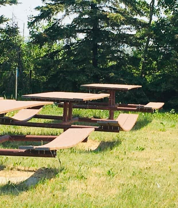 Shelly Clauson snapped this photo in Clairmont, Alta.  She believes the benches are made of some sort of composite plastic material that warped due to the heat. (Submitted by Shelly Clauson - image credit)