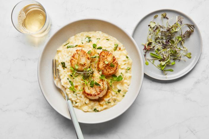 """You might not think of risotto as being a summer dish, but this one absolutely is. Instead of wine, there's pineapple juice adding flavor to the creamy rice. <a href=""""https://www.epicurious.com/recipes/food/views/seared-scallops-with-basil-risotto?mbid=synd_yahoo_rss"""" rel=""""nofollow noopener"""" target=""""_blank"""" data-ylk=""""slk:See recipe."""" class=""""link rapid-noclick-resp"""">See recipe.</a>"""