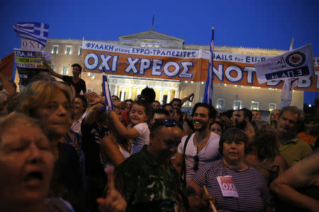 Protesters shout slogans in front of the parliament building during an anti-austerity rally in Athens, Greece, June 29, 2015. REUTERS/Alkis Konstantinidis