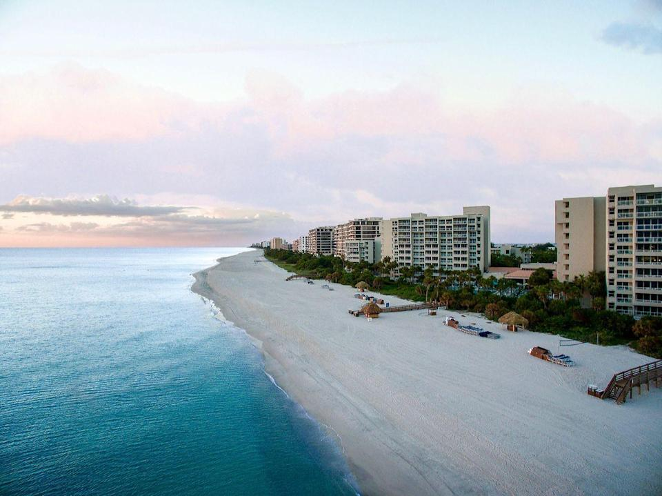 "<p>We'd argue some of the most beautiful sunsets find themselves on Longboat Key's coastline, and this sprawling resort has the best seat in the house. <a href=""https://www.longboatkeyclub.com/"" rel=""nofollow noopener"" target=""_blank"" data-ylk=""slk:The Resort at Longboat Key Club"" class=""link rapid-noclick-resp"">The Resort at Longboat Key Club</a> offers fabulous beaches, golfing, spa facilities, tennis, boating, and proximity to local activities. Sandwiched in between Anna Maria Island and Sarasota, there are so many things to do, eat, drink, and see—if you can pull yourself away from the white-sand beach. </p>"