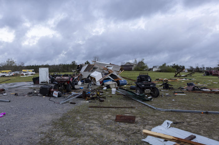 Debris litters weather-damaged properties at the intersection of County Road 24 and 37 in Clanton, Ala., the morning following a large outbreak of severe storms across the southeast, Thursday, March 18, 2021. (AP Photo/Vasha Hunt)