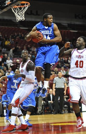 Middle Tennessee's Marcos Knight (14) grabs the ball against Arkansas State's Kendrick Washington (40) and Brandon Peterson (15) during their NCAA college basketball game, Thursday, Jan. 3, 2013, in Jonesboro, Ark. (AP Photo/The Jonesboro Sun, Krystin McClellan)