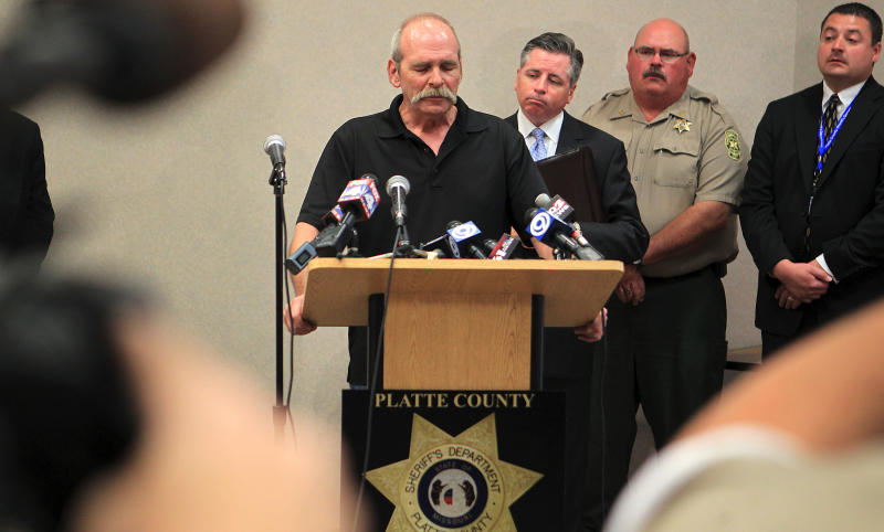 Paul Haarup, father of Britny Haarup, 19, and Ashley Key, 22, speaks at a press conference regarding their murder Monday, July 16, 2012, at the Platte County Resource Center in Kansas City, Mo. Clifford D. Miller was charged Monday with two counts of first-degree murder in the deaths of the two sisters in Edgerton, Mo. (AP Photo/St. Joseph News-Press, Eric Keith)