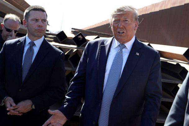 PHOTO: President Donald Trump talks with reporters as he tours a section of the southern border wall, in Otay Mesa, Calif., as acting Homeland Secretary Kevin McAleenan listens, Sept. 18, 2019. (Evan Vucci/AP, FILE)
