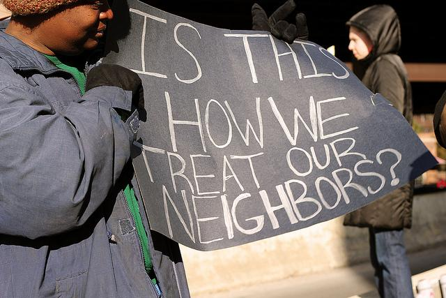 Homeless advocates protest with sign: