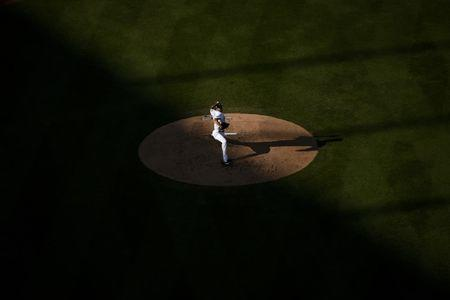 Jul 4, 2018; Los Angeles, CA, USA; Los Angeles Dodgers starting pitcher Rich Hill (44) pitches during the third inning against the Pittsburgh Pirates at Dodger Stadium. Mandatory Credit: Kelvin Kuo-USA TODAY Sports