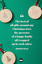 <p>The best of all gifts around any Christmas tree: the presence of a happy family all wrapped up in each other. </p>