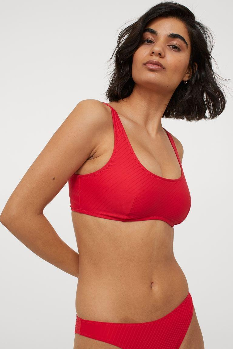 <p>H&amp;M is a great resource for affordable swim. This minimalist cut from the conscious collection looks sophisticated and elevated in poppy red. Shop the <span>Bikini Top</span> ($18) and <span>Bikini Bottom</span> ($13).</p>