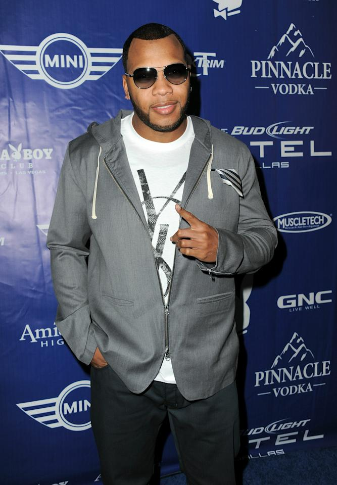 DALLAS, TX - FEBRUARY 04:  Flo Rida attends the Bud Light Hotel Playboy Party with performances by Snoop Dogg, Warren G and Flo Rida on February 4, 2011 in Dallas, Texas.  (Photo by Jordan Strauss/Getty Images for Bud Light)