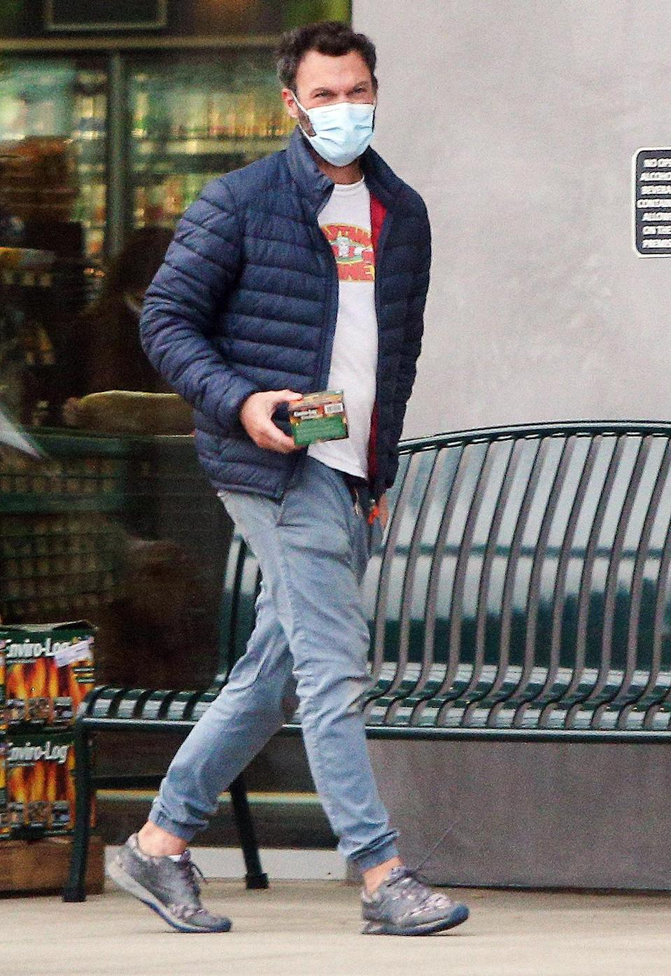 <p>A masked Brian Austin Green runs a quick errand at Whole Foods in Malibu on Monday.</p>