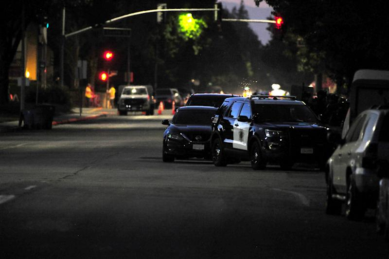 CALIFORNIA, USA - JULY 28 : Police and fire personnel line the streets of Gilroy searching for the second of two active shooter after shooting broke out in California garlic festival in Gilroy, California on July 28, 2019. At least three people were killed on Sunday in an ongoing shooting at a festival in northern California, according to a local official. (Photo by Neal Waters/Anadolu Agency via Getty Images)