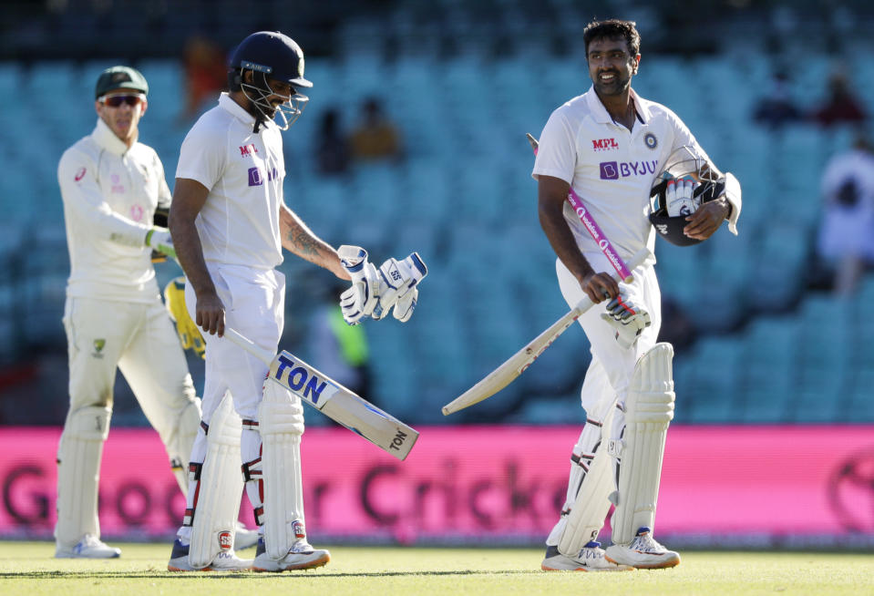 Not out batsman India's Ravichandran Ashwin, right, and Hanuma Vihari walk from the field following play on the final day of the third cricket test between India and Australia at the Sydney Cricket Ground, Sydney, Australia, Monday, Jan. 11, 2021. The test ended in a draw and the series is at 1-1 all with one test to play. (AP Photo/Rick Rycroft)