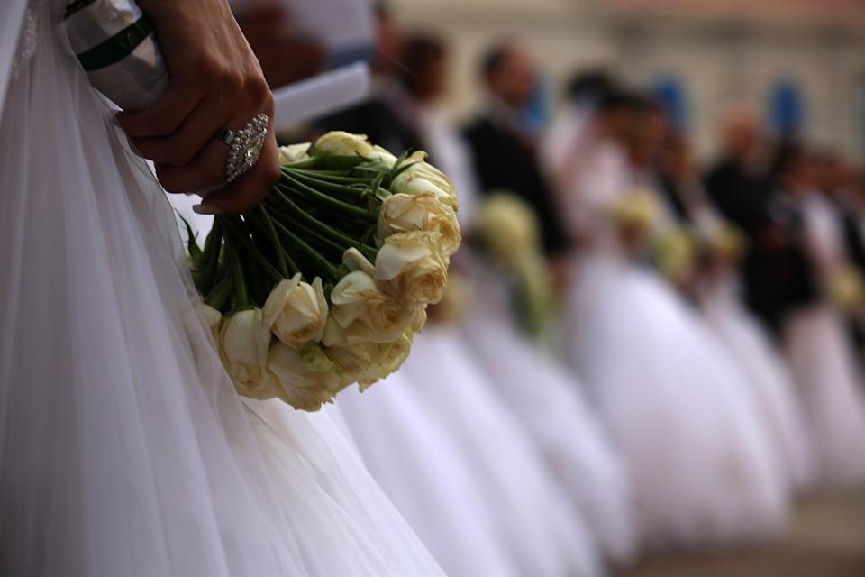 A bride admits to fattening up her two sisters so she can be the center of attention at her wedding. (Photo: Patrick Baz/AFP/Getty Images)