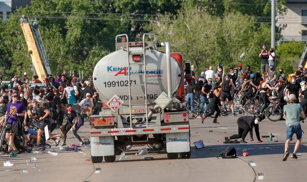 A tanker truck drives into thousands of protesters marching on 35W north bound highway during a protest against the death of George Floyd, in Minneapolis, Minnesota.
