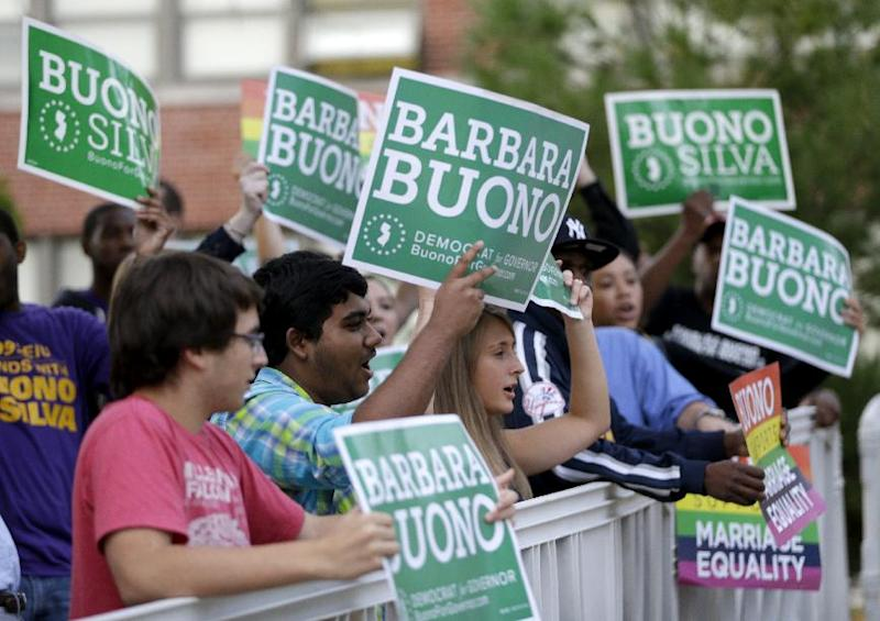 Supporters of Barbara Buono, the Democratic candidate in the New Jersey gubernatorial race, gather before Buono and Republican Gov. Chris Christie met for a debate at William Paterson University, Tuesday, Oct. 8, 2013, in Wayne, N.J. (AP Photo/Julio Cortez)