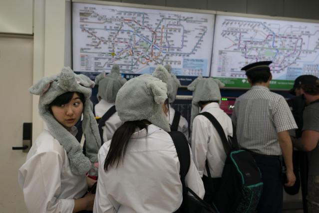 A group of Japanese junior high school students buy subway tickets at Meiji-jingumae 'Harajuku' Station, May 29, 2019, in Tokyo. Japan's child population has declined for the 38th year in a row and is now at a record low according to a data released in May. (AP Photo/Jae C. Hong)