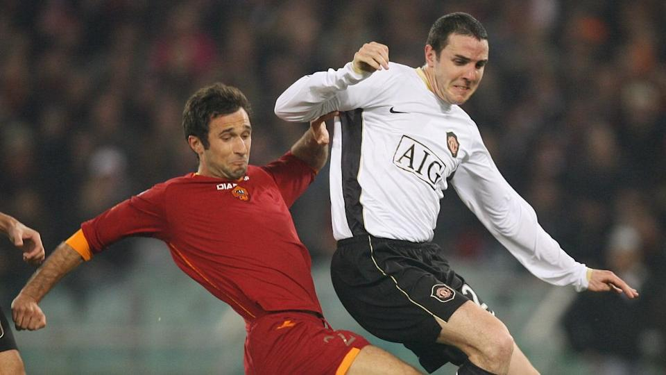 Roma's Mirko Vucinic (G) fights for the... | CHRISTOPHE SIMON/Getty Images