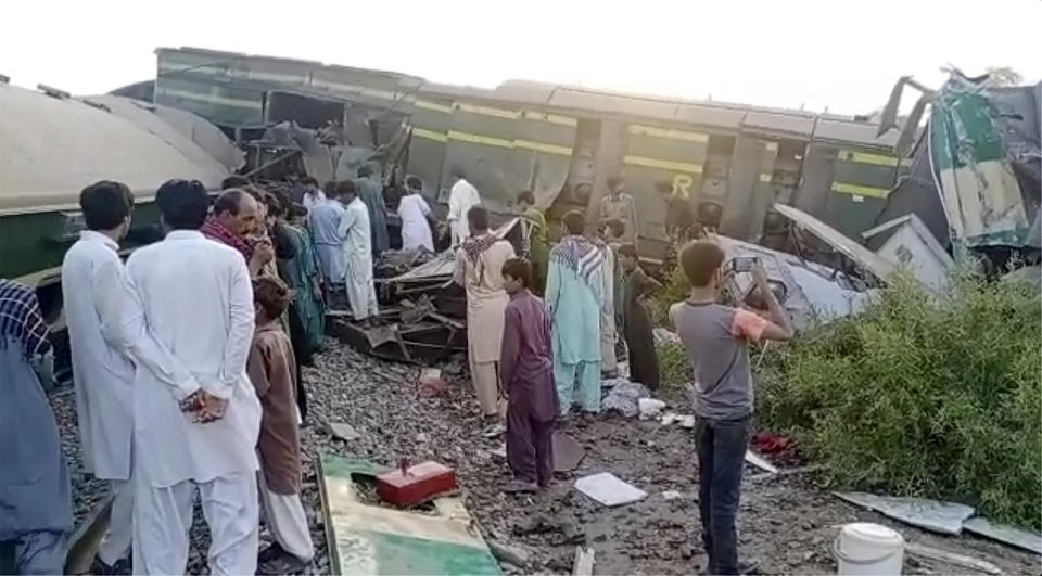 A video still of people at the scene of the Pakistan crash where two trains collided.