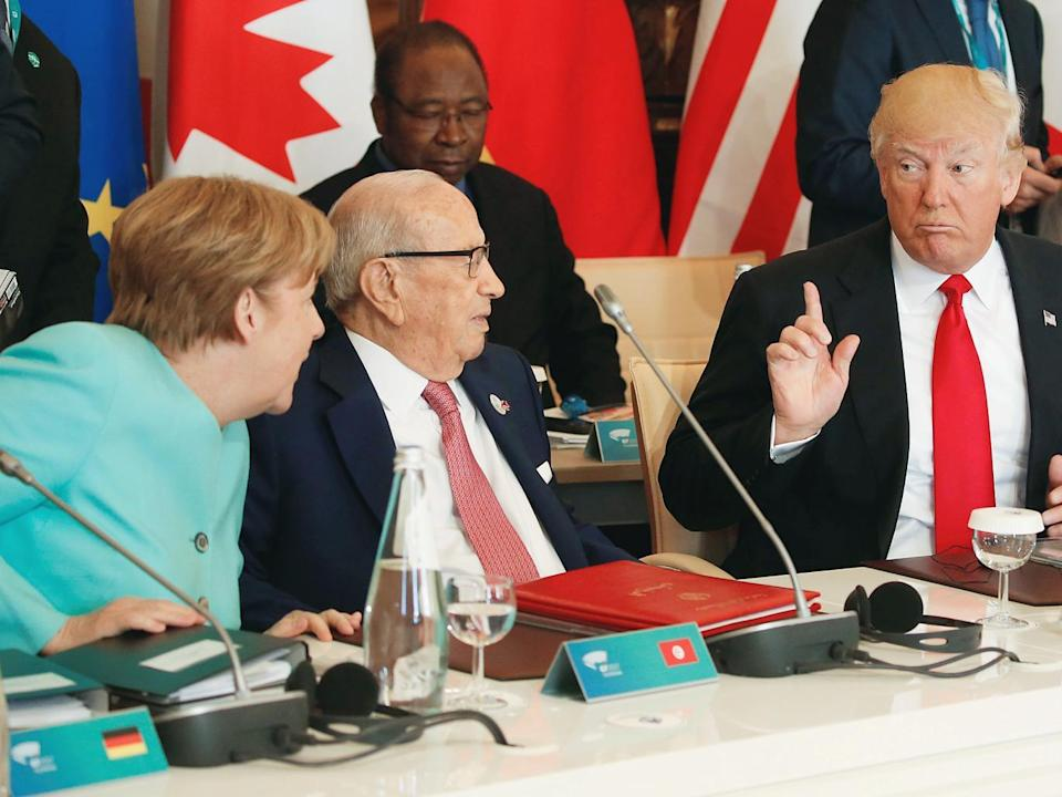 Race against time: Ms Merkel failed to elicit cooperation from Mr Trump on the 2015 Paris climate deal (Reuters)
