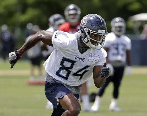 Tennessee Titans wide receiver Corey Davis runs a drill during an organized team activity at its NFL football training facility Tuesday, May 22, 2018, in Nashville, Tenn. Injuries limited Davis in his rookie season as the first wide receiver drafted in 2017. (AP Photo/Mark Humphrey)