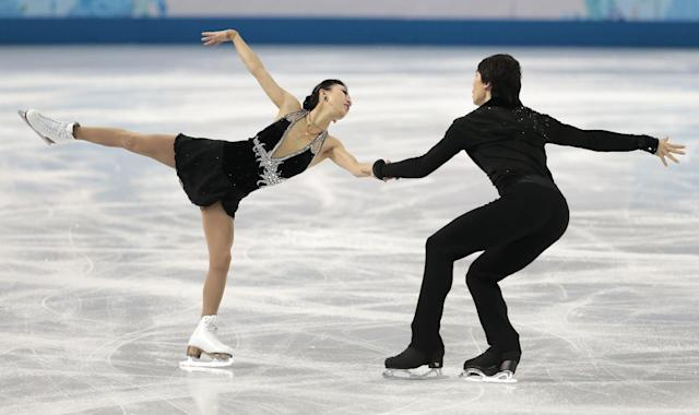 Pang Qing and Tong Jian of China compete in the pairs short program figure skating competition at the Iceberg Skating Palace during the 2014 Winter Olympics, Tuesday, Feb. 11, 2014, in Sochi, Russia. (AP Photo/Ivan Sekretarev)