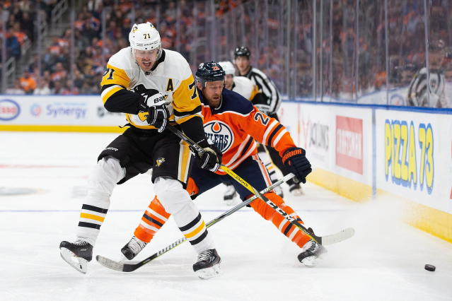 Edmonton Oilers' Kyle Brodziak (28) battles against Pittsburgh Penguins' Evgeni Malkin (71) during the first period of an NHL hockey game, in Edmonton, Alberta, Tuesday, Oct. 23, 2018. (Codie McLachlan/The Canadian Press via AP)