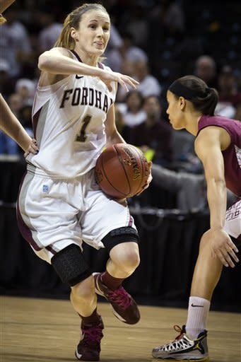 Fordham's Erin Rooney (1) looks to pass during the first half of their NCAA college basketball championship game against Saint Joseph's at the Atlantic 10 Conference tournament, Saturday, March 16, 2013, in New York. (AP Photo/John Minchillo)