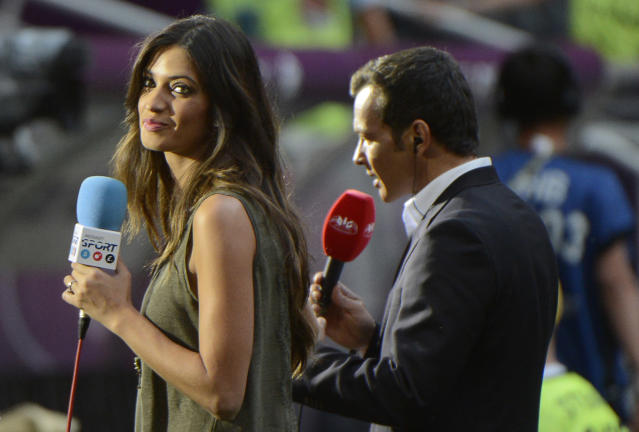 Spanish television presenter and girlfriend of Spain's goalkeeper Iker Casillas, Sara Carbonero (L) looks on during the Euro 2012 football championships semi-final match Portugal vs Spain on June 27, 2012 at the Donbass Arena in Donetsk. AFP PHOTO / PIERRE-PHILIPPE MARCOUPIERRE-PHILIPPE MARCOU/AFP/GettyImages