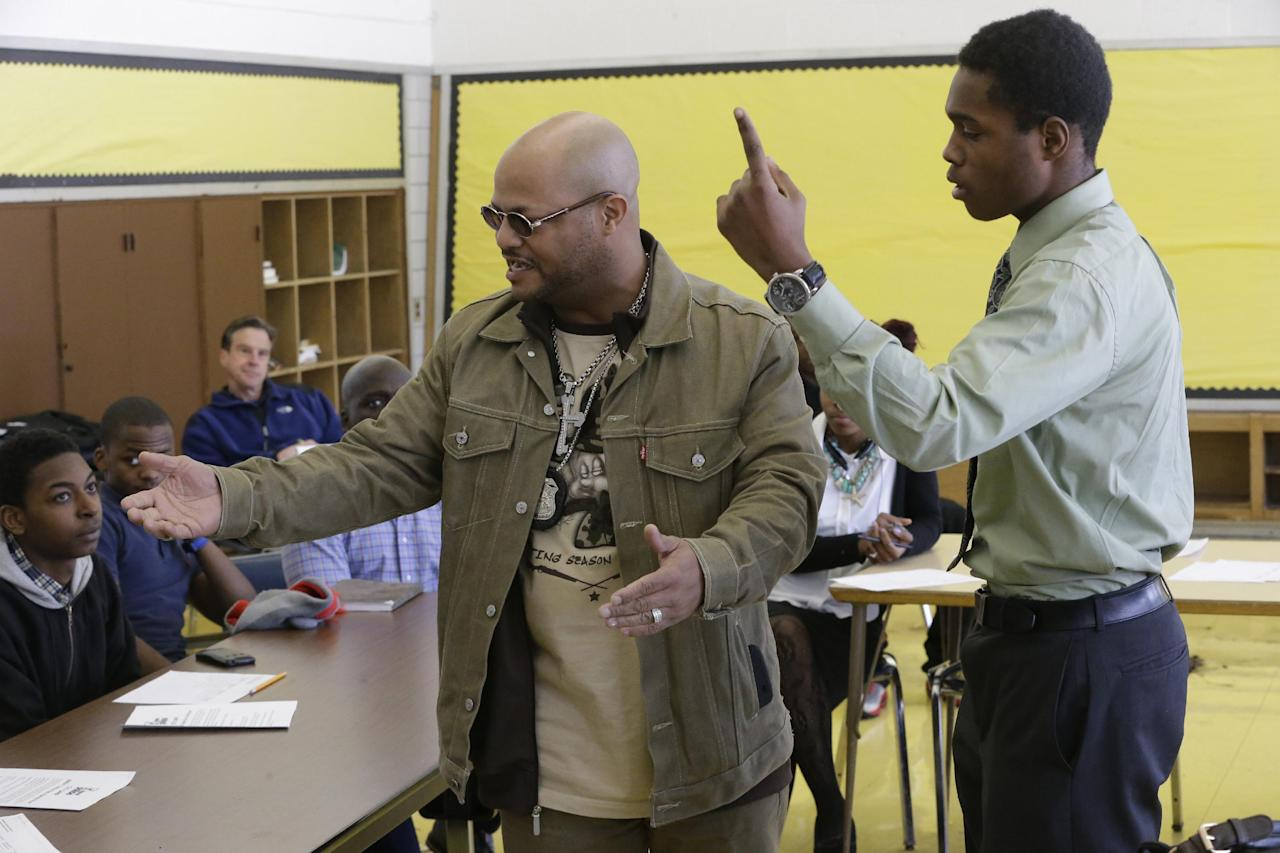 "In this Feb. 27, 2014 photo, police officer Melvin Chuney, left, and student Jalen Pickett, speak during a class that teaches anger management and conflict resolution skills at Cody High School in Detroit. Jalen said he was neglected by both parents and now lives with a cousin, though he's determined to help out his mother financially. ""I fought - but that's like every boy,"" he said. ""I have a clean record, I've never been locked up ... I never give up hope."" (AP Photo/Carlos Osorio)"