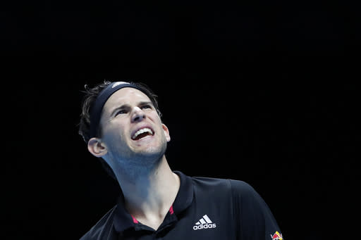 Dominic Thiem of Austria is dejected after losing a point to Andrey Rublev of Russia during their doubles tennis match at the ATP World Finals tennis tournament at the O2 arena in London, Thursday, Nov. 19, 2020. (AP Photo/Frank Augstein)