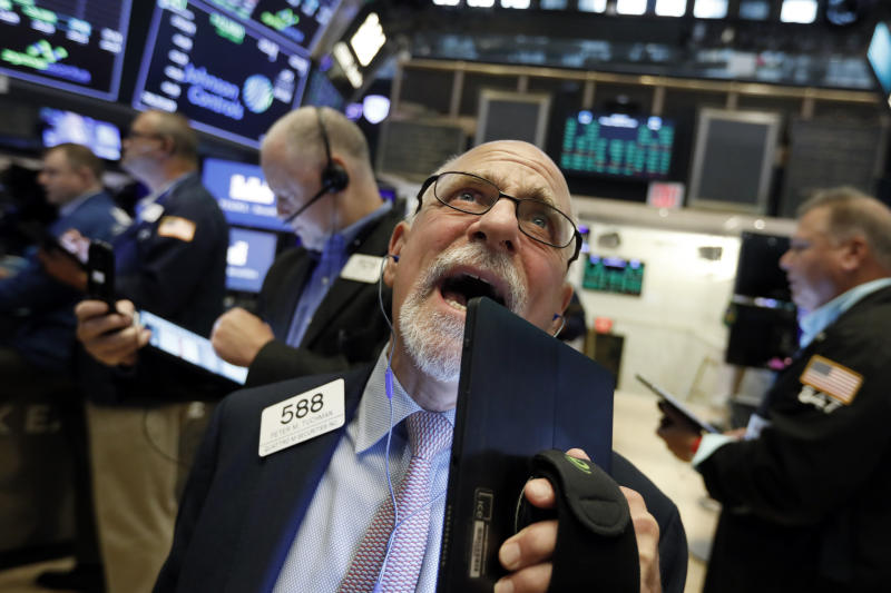 Trader Peter Tuchman works on the floor of the New York Stock Exchange, Friday, Aug. 16, 2019. Stocks are opening broadly higher at the end of a turbulent week. (AP Photo/Richard Drew)