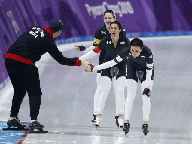 <p>Team U.S.A. with Heather Bergsma, front, Brittany Bowe, center, and Mia Manganello, rear, celebrates with their coach after the quarterfinals of the women's team pursuit speedskating race at the Gangneung Oval at the 2018 Winter Olympics in Gangneung, South Korea, Monday, Feb. 19, 2018. (AP Photo/John Locher) </p>