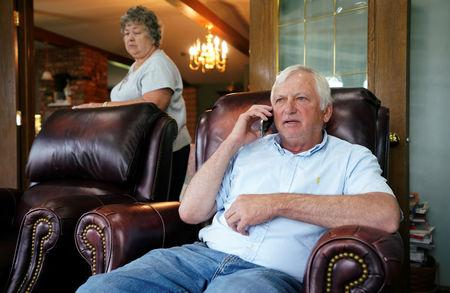 Farmer Ken Ries talks to one of his employees on the phone at his hog farm in Ryan, Iowa, U.S., May 18, 2019. Picture taken May 18, 2019.  REUTERS/Ben Brewer