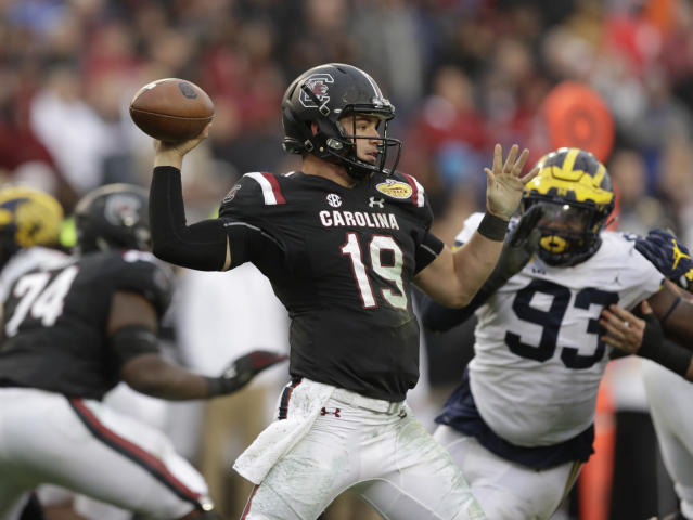FILE - In this Jan. 1, 2018, file photo, South Carolina quarterback Jake Bentley throws a pass against Michigan during the second half of the Outback Bowl NCAA college football game, in Tampa, Fla. New South Carolina quarterbacks coach Dan Werner was brought on by South Carolina coach Will Muschamp to help ignite an offense thats been near the bottom of the Southeastern Conference the past two seasons. So far, so good, according to two-year starter Jake Bentley. (AP Photo/Chris O'Meara, File)