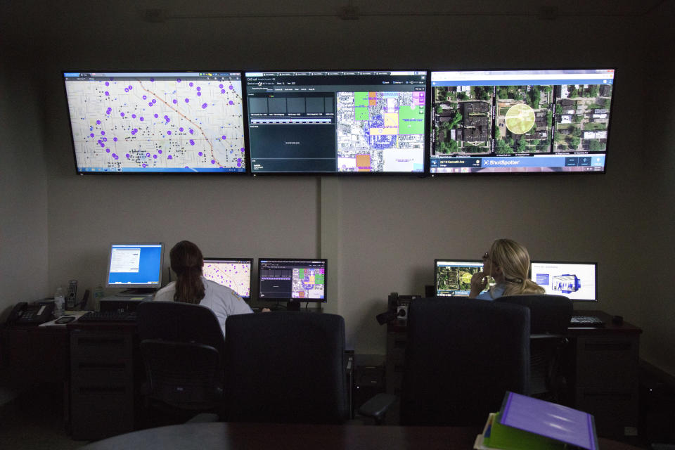 """FILE - In this Wednesday, Feb. 8, 2017 file photo, members of the Chicago Police Department work with new predictive and tracking ShotSpotter technologies in a strategic decision support center at the Chicago Police Department's 11th district headquarters. In a Monday, May 3, 2021 court filing, community groups argued the gunshot detection system routinely reports gunshots where there are none, sending officers into predominantly Black and Latino neighborhoods for """"unnecessary and hostile"""" encounters. (Erin Hooley/Chicago Tribune via AP, File)"""