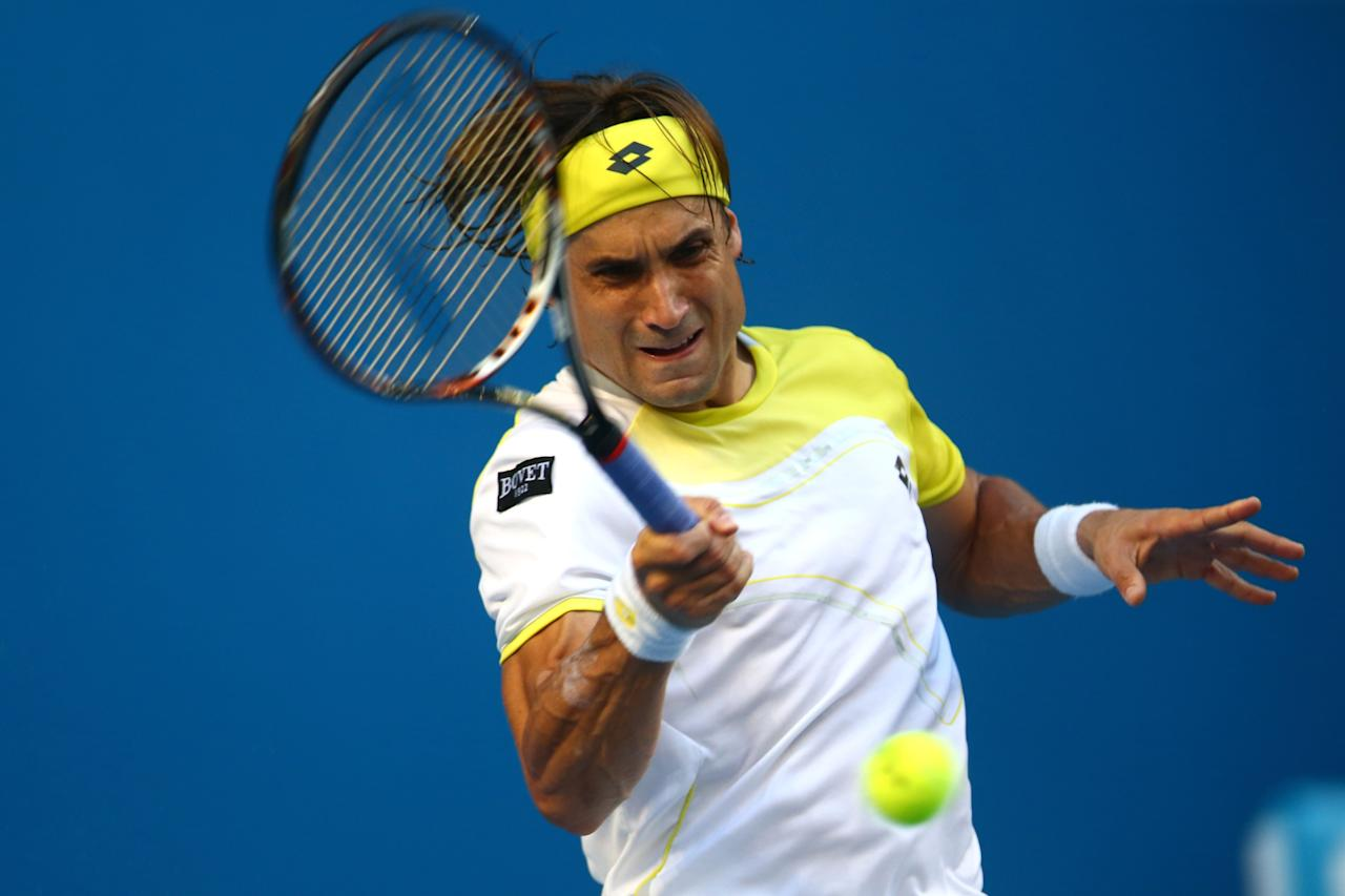 MELBOURNE, AUSTRALIA - JANUARY 14:  David Ferrer of Spain plays a forehand in his first round match against Olivier Rochus of Belgium during day one of the 2013 Australian Open at Melbourne Park on January 14, 2013 in Melbourne, Australia.  (Photo by Mark Kolbe/Getty Images)
