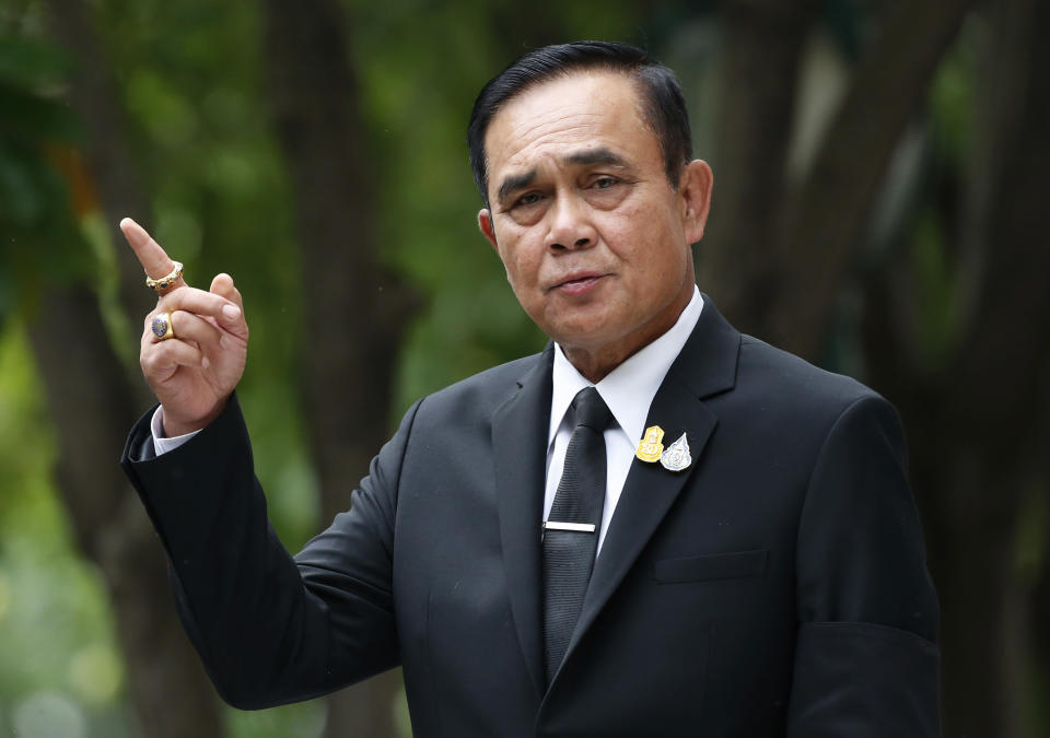 Thailand's Prime Minister Prayuth Chan-ocha talks to reporters before a meeting at government house in Bangkok, Thailand, Thursday, June 6, 2019. Thailand's Parliament elected 2014 coup leader Prayuth Chan-ocha as prime minister in a vote Wednesday that helps ensure the military's sustained dominance of politics since the country became a constitutional monarchy nearly nine decades ago. (AP Photo/Sakchai Lalit)